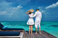 Couple on a beach jetty at maldives tropical Royalty Free Stock Photography