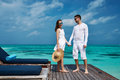 Couple on a beach jetty at maldives tropical Royalty Free Stock Photo
