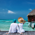 Couple on a beach jetty at maldives tropical Stock Images