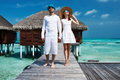 Couple on a beach jetty at maldives tropical Royalty Free Stock Photos