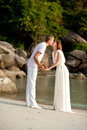 Couple on the beach kiss in white Royalty Free Stock Photos