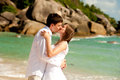 Couple on the beach kiss in white Royalty Free Stock Photo