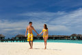 Couple on a beach at maldives tropical Royalty Free Stock Image