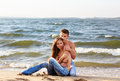 Couple at the beach outdoor portrait of beautiful romantic of topless girl and muscular guy in jeans on Stock Photos