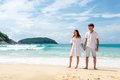 Couple on beach standing and looking far away lovely tropical Stock Image