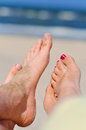 Couple beach woman s man s bare feet Royalty Free Stock Image
