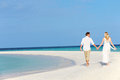 Couple beautiful beach wedding holding hands Stock Images