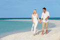 Couple beautiful beach wedding holding hands Stock Image