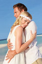 Couple beautiful beach wedding hugging Stock Photo