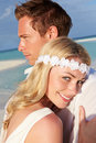 Couple beautiful beach wedding smiling Stock Photos