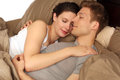 Couple in bed happy young laying Stock Image