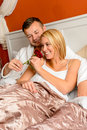 Couple bed smelling rose romantic Valentine's day Stock Images