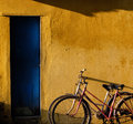 Couple of bicycle on old wall background at hoi an town two cycle make shade yellow Royalty Free Stock Images