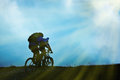 Couple on bicycles silhouette of against clouds and sky Royalty Free Stock Image