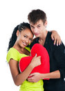 Couple with a big heart on white background Royalty Free Stock Images