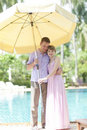 Couple with big sun umbrella Royalty Free Stock Image