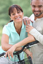 Couple with bike Stock Photography