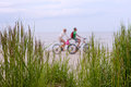 Couple on a bike ride along the beach Royalty Free Stock Photo