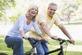 Couple on bikes outdoors smiling Stock Photo