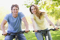 Couple on bikes outdoors smiling Stock Photography