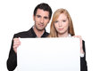 Couple with a blank poster Royalty Free Stock Photo