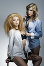 Couple blonde women in sexy pose creative portrait of two sensual girls with fashion hair style and make up posing with Royalty Free Stock Photo