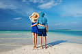 Couple in blue on a beach at maldives tropical Royalty Free Stock Images