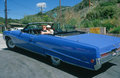 Couple in a blue Buick Electra convertible Royalty Free Stock Photo