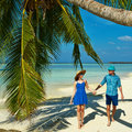 Couple in blue clothes on a beach at Maldives Stock Photography
