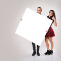 Couple With Board Stock Photography
