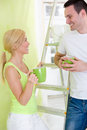 Couple on break while renovating new coffee their house Stock Photos