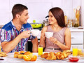 Couple breakfast at kitchen. Royalty Free Stock Images