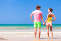 Couple in bright clothes on tropical beach in thailand this image has attached release Stock Photography