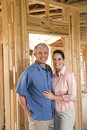 Couple Building Home Stock Photography