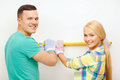 Couple building using spirit level to measure repair and home concept smiling new home Royalty Free Stock Images