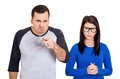 Couple bully man nerd woman closeup portrait of husband men standing upfront angry pointing at you and shy wife nerdy women Royalty Free Stock Image