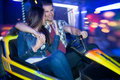 Couple in a bumper car young driving dodgem ride Royalty Free Stock Photo