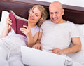 Couple burring with laptop mature indoors Stock Photos