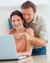 Couple busy working together on a laptop Royalty Free Stock Photo