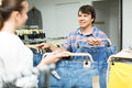 Couple buying blue jeans at store Royalty Free Stock Photo