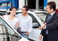 Couple buying a car Stock Image