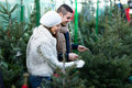 Couple buying Christmas tree star