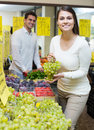 Couple buying fresh seasonal fruits in market Royalty Free Stock Photo