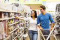 Couple buying padlock young in hardware store Stock Image