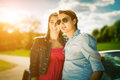 Couple with cabriolet car in spring on day trip Royalty Free Stock Photo