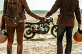 Couple and cafe racer motorcycle Royalty Free Stock Photo