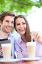 Couple at cafe young drinking latte Stock Photo