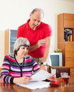 Couple calculating family budget serious mature Stock Images