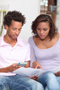 Couple calculating their budget working out monthly Stock Images
