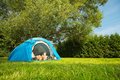 Couple on camping a tent a grassy meadow Stock Photography